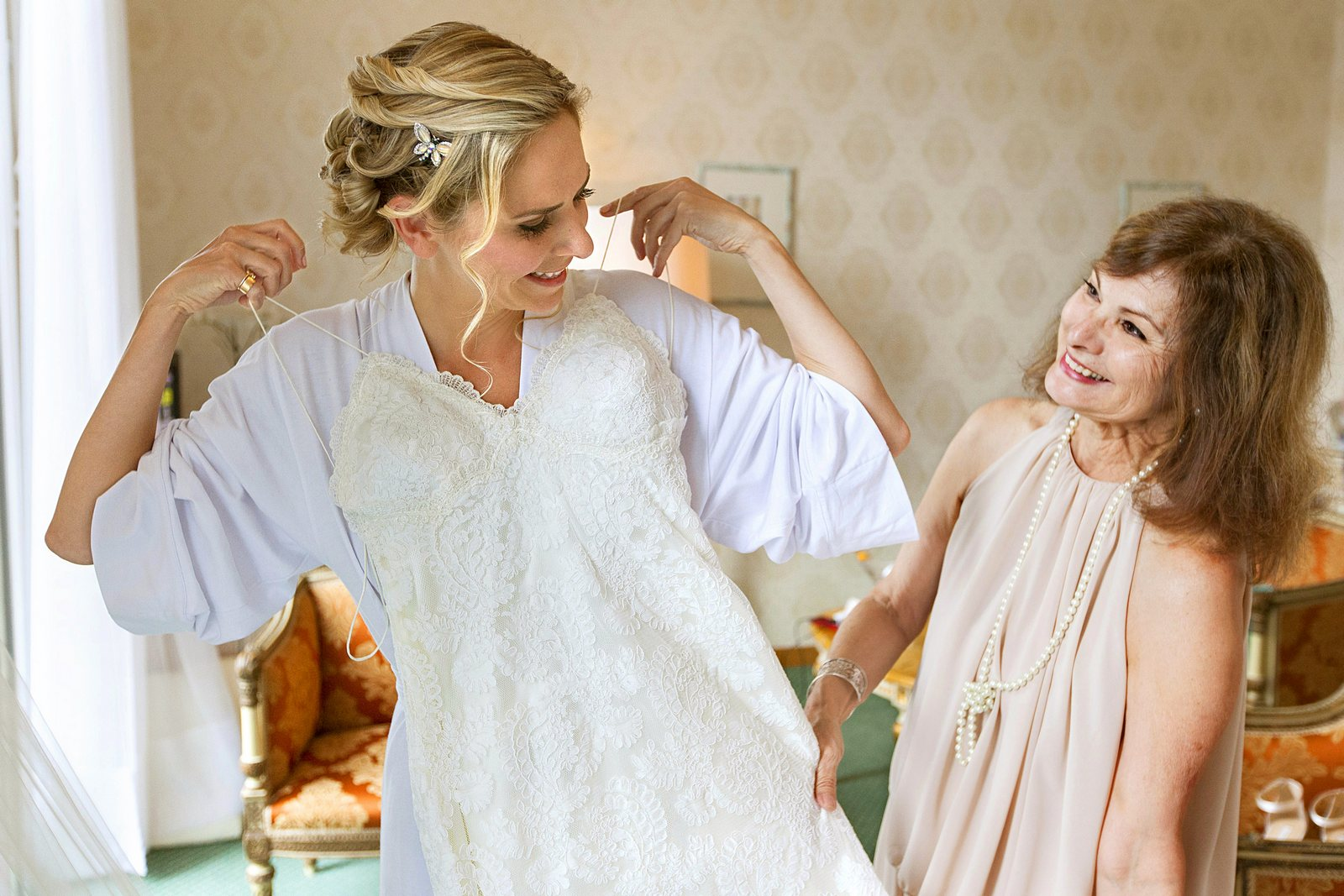 beautiful bride gets ready for wedding on lake como