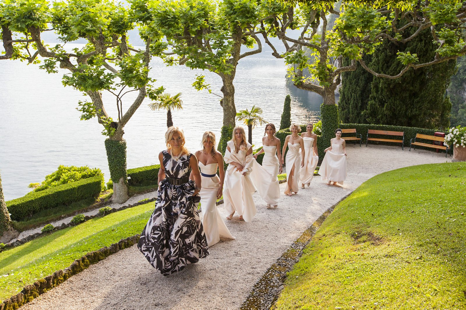 bride walks to wedding ceremony Villa Balbianello